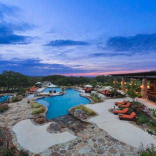 Huge mountain style backyard stone and custom-shaped pool photo in Austin