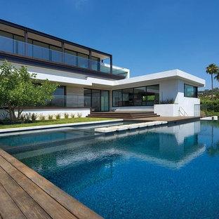 Pool - modern backyard custom-shaped pool idea in Orange County