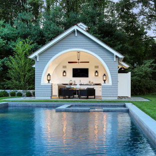 Small traditional pool in New York with a pool house.