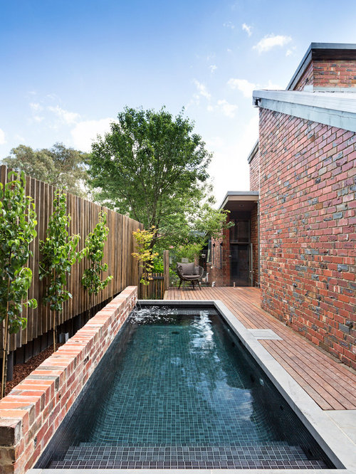 Small Contemporary Rectangular Pool In Melbourne With A Water Feature And  Decking.