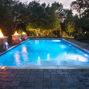 Example of a mid-sized classic backyard concrete paver and rectangular lap pool design in Chicago