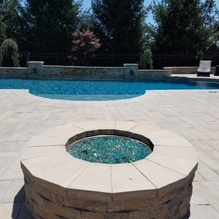 Roman Style Precision Pool with raised wall, fire pit & outdoor kitchen