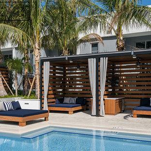 Diseño de casa de la piscina y piscina natural, minimalista, grande, en forma de L, en azotea, con adoquines de ladrillo
