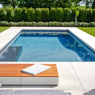 Idées déco pour une grand piscine contemporaine rectangle avec du béton estampé.