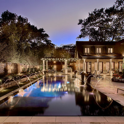 Pool - large traditional courtyard rectangular and stamped concrete lap pool idea in Chicago