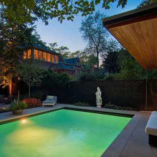 Inspiration for a mid-sized modern backyard rectangular and stone lap pool remodel in Toronto