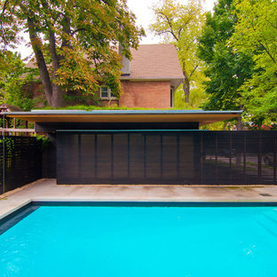 Inspiration for a mid-sized modern backyard stone and rectangular pool remodel in Toronto