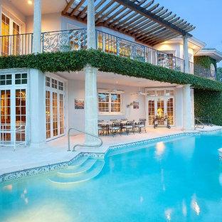 Pool - mediterranean custom-shaped pool idea in Miami