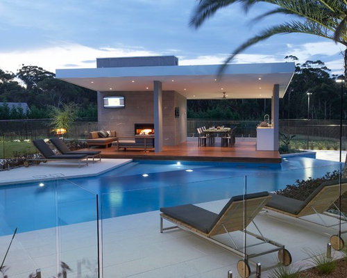 Inspiration For A Large Modern Backyard Custom Shaped Infinity Pool House  Remodel In Sydney