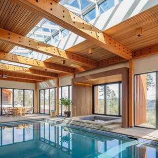 Example of a mountain style indoor rectangular pool design in Other