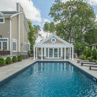 Inspiration for a timeless backyard rectangular lap pool house remodel in New York