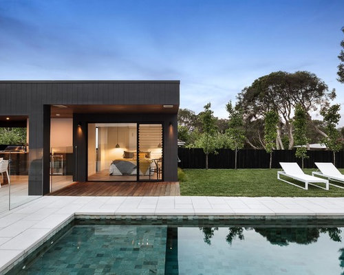 Modern One Storey Black Exterior In Melbourne With Wood Siding And A Flat  Roof. Part 83