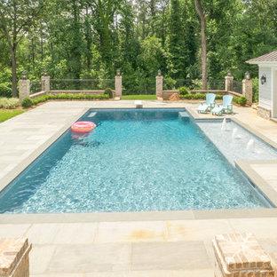 Foto de casa de la piscina y piscina de estilo americano, grande, rectangular, en patio trasero, con adoquines de hormigón