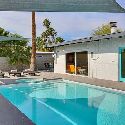 Example of a large 1960s backyard concrete and rectangular lap hot tub design in Phoenix