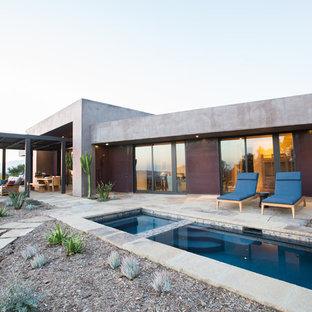 Modelo de piscinas y jacuzzis alargados, de estilo americano, de tamaño medio, rectangulares, en patio trasero