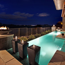 Contemporary Pool by Pinnacle Architectural Studio