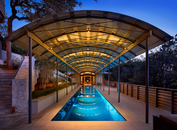 Inspired by olympic swimming feats dive in with a lap pool for Pool design companies