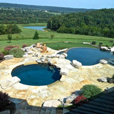 Rustic Pool by Forte Building Group, LLC