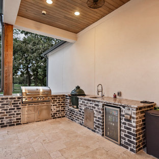 Design ideas for a mid-sized backyard custom-shaped natural pool in Houston with natural stone pavers.