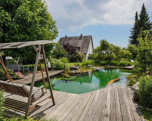 wohnidee fr groe landhaus schwimmteich neben dem haus in individueller form mit dielen in stuttgart - Hinterhof Mit Pooldesignideen
