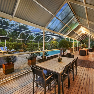 Screen Pool Enclosure for a Rural Home with a difference
