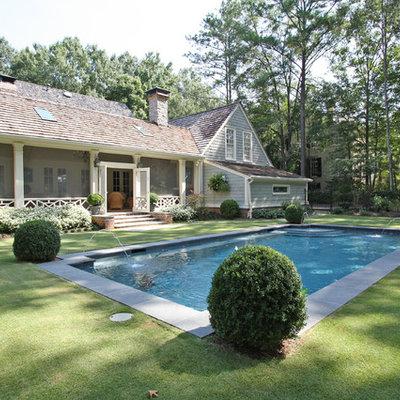 Example of a mid-sized classic backyard rectangular lap pool fountain design in Atlanta