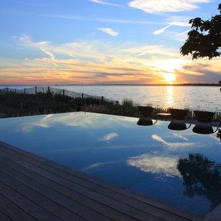 seaside glass tile vanishing edge infinity swimming pool + spa