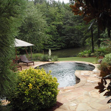 Traditional Pool Secluded Suburban Backyard Retreat by Lawns by Hand, Inc.