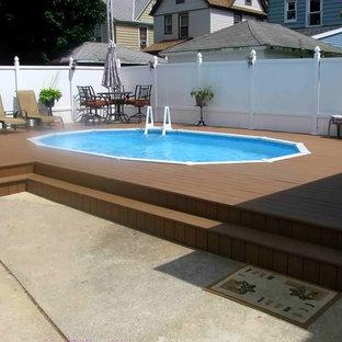 Mid Sized Elegant Backyard Round Aboveground Pool Photo In New York With Decking