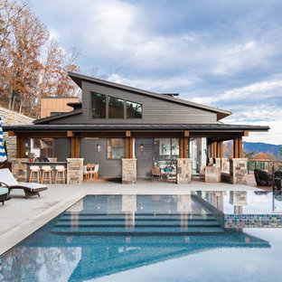 Example of a 1960s backyard concrete and rectangular infinity hot tub design in Other
