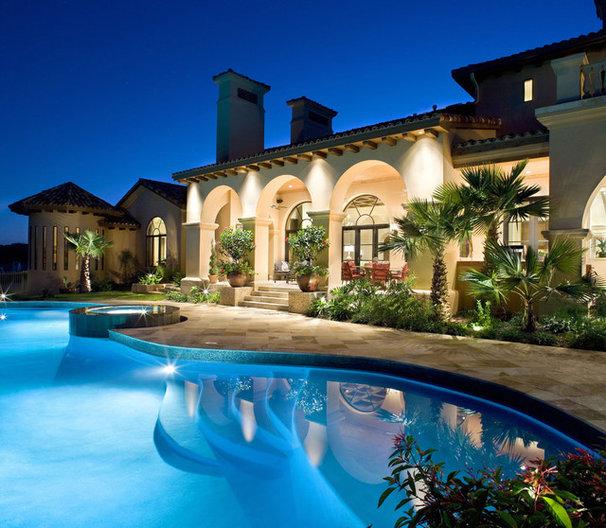 Mediterranean Pool by JAUREGUI Architecture Interiors Construction