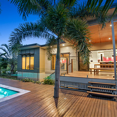 Inspiration for a large modern backyard stone and rectangular aboveground pool remodel in Brisbane