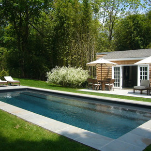 Example of a beach style pool house design in New York