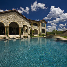 Traditional Pool by Cornerstone Architects