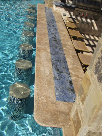 Mediterranean Swimming Pool by JDM Countertops, Inc.