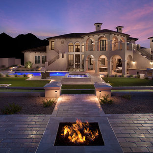 Trendy backyard stone pool photo in Phoenix