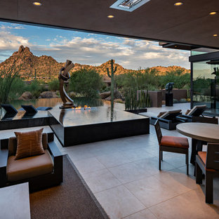 Inspiration for a large contemporary backyard tile and rectangular infinity hot tub remodel in Phoenix