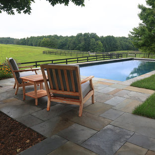 Inspiration for a country backyard tile and rectangular lap pool remodel in DC Metro