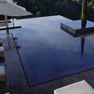 Sleek Wooden Deck Flows into Pool