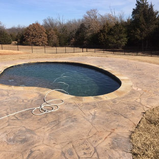 Inspiration for a rustic pool remodel in Oklahoma City