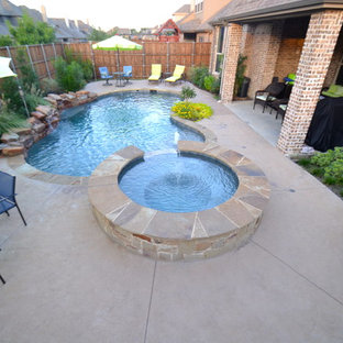 Small country backyard custom-shaped pool in Dallas.