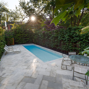 Inspiration for a small traditional backyard rectangular pool in Toronto with natural stone pavers.