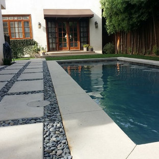 Photo of a small modern backyard rectangular pool in Los Angeles with concrete pavers.