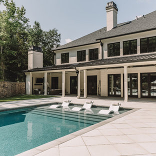 Example of a transitional backyard rectangular and concrete paver lap pool design in Birmingham