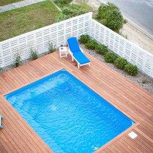 Diseño de piscina tradicional, rectangular, con entablado