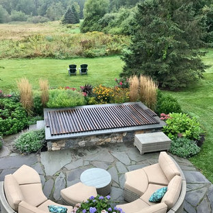 Inspiration for a small traditional backyard rectangular natural pool in Boston with a hot tub and natural stone pavers.