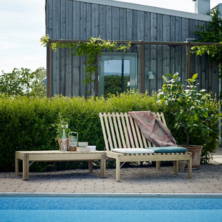 Inspiration for a mid-sized scandinavian rectangular aboveground pool in Berlin with brick pavers.