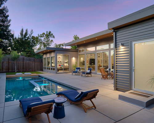 trendy backyard concrete and rectangular hot tub photo in san francisco