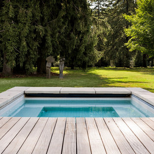 Example of a trendy pool design in Ottawa with decking