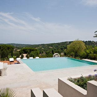 Large tuscan rectangular pool photo in Orlando